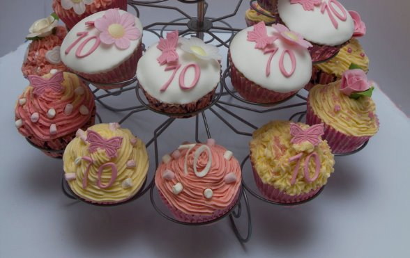 a variety of 24 cupcakes on a stand